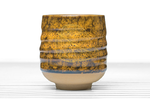 Cylindrical Tea Bowl With Speckled Yellow And Brown Glaze And Golden Leaf Pattern
